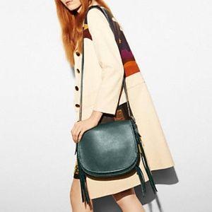 coach whiplash saddle bag in mineral color ( teal